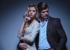 Stylish Man and Luxurious Woman. Luxurious Fashion Couple posing in studio stock photo