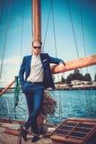 Stylish man on a luxury regatta Stock Images