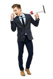 Stylish man with megaphone. Young man over white background Royalty Free Stock Photo