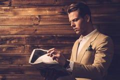 Stylish man with newspapep Stock Photography