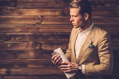 Stylish man with newspapep Stock Images