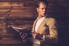 Stylish man with newspaper Stock Photo