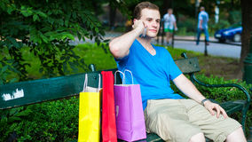 Stylish man on the phone at the park. Royalty Free Stock Photo