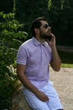 Stylish man with phone in a park Stock Photo