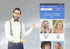 Stylish Man pointing at a Dating App Interface Royalty Free Stock Photography