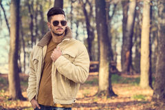 Stylish man posing in autumn park Stock Photos