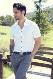 Stylish man posing outdoor. Stylish man with a preppy style posing outdoor Stock Photo