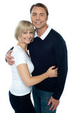 Stylish man in pullover embracing his blonde wife Stock Image