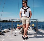 Stylish man on a regatta Royalty Free Stock Images