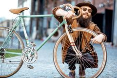 Stylish man with retro bicycle outdoors stock photos