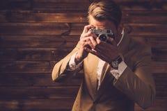 Stylish man with retro camera Stock Photography
