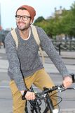 Stylish man riding a bicycle in the city.  Stock Photography
