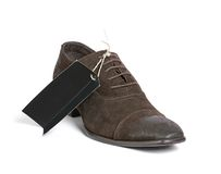 Stylish man's shoes with a label Royalty Free Stock Photo