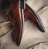 Stylish man's shoes and a suit Royalty Free Stock Image