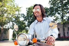 Stylish man on scooter Stock Image