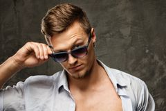 Stylish man in shirt and sunglasses Royalty Free Stock Image