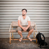 Stylish man sitting on a bench Royalty Free Stock Photo