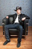 A stylish man sitting in leather chair Stock Images