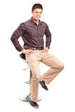 Stylish man sitting on a modern chair Royalty Free Stock Photo