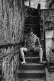 Stylish man sitting on the steps Royalty Free Stock Image