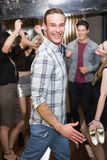 Stylish man smiling on the dancefloor. Stylish men smiling on the dancefloor at the bar Stock Photos