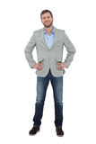 Stylish man smiling with hands on hips looking at camera Royalty Free Stock Photos
