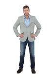 Stylish man smiling with hands on hips Royalty Free Stock Photos