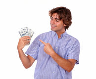Stylish man smiling while pointing to the currency Royalty Free Stock Photo