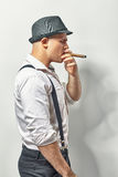 Stylish man smoking cigar Royalty Free Stock Images