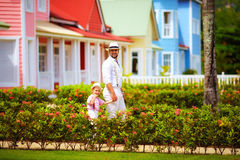 Stylish man with son walking on the caribbean street Stock Photos