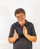 Stylish  man standing and gesturing with his hands Stock Photos