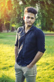 Stylish man standing outdoor in natural light Royalty Free Stock Photography