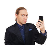 Stylish man in suit with mobile phone isolated. Royalty Free Stock Photo