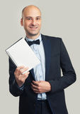 Stylish man in suit shows a blank sheet Stock Photo