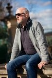 Stylish man in sunglasses enjoying the sun Royalty Free Stock Image