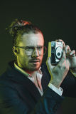 Stylish man taking photo on point-and-shoot camera Royalty Free Stock Images