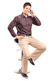 Stylish man talking on a cell phone Stock Image