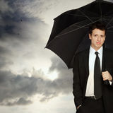 Stylish Man with Umbrella. Portrait of a Young Stylish Business Man with Umbrella Royalty Free Stock Photography
