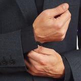 Stylish man unbuttons his sleeve business suit closeup Stock Photo