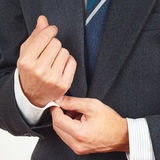 Stylish man unbuttons his sleeve suit closeup Royalty Free Stock Photography