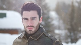 Handsome confident man in mountain with snow