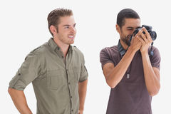 Stylish man watching his friend taking a picture Royalty Free Stock Photo