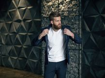 Stylish man wearing a jacket and looking away royalty free stock photos
