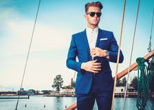 Stylish man on a wooden regatta Stock Images