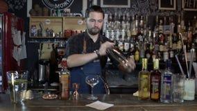 Bartender shaking bottle preparing beverages in bar