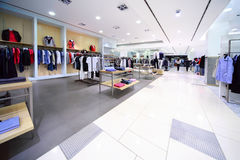 Stylish masculine clothes are for sale in shop. Stylish masculine clothes are for sale in modern empty shop stock images
