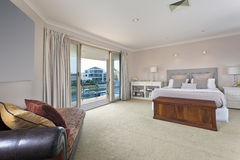 Stylish master bedroom in australian mansion Stock Photo