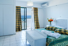 Stylish master bedroom in modern resort hotel in Greece royalty free stock photography