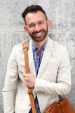 Stylish mature man with shoulder bag Stock Photo