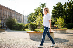 Stylish mature woman against modern urban environment Stock Photography